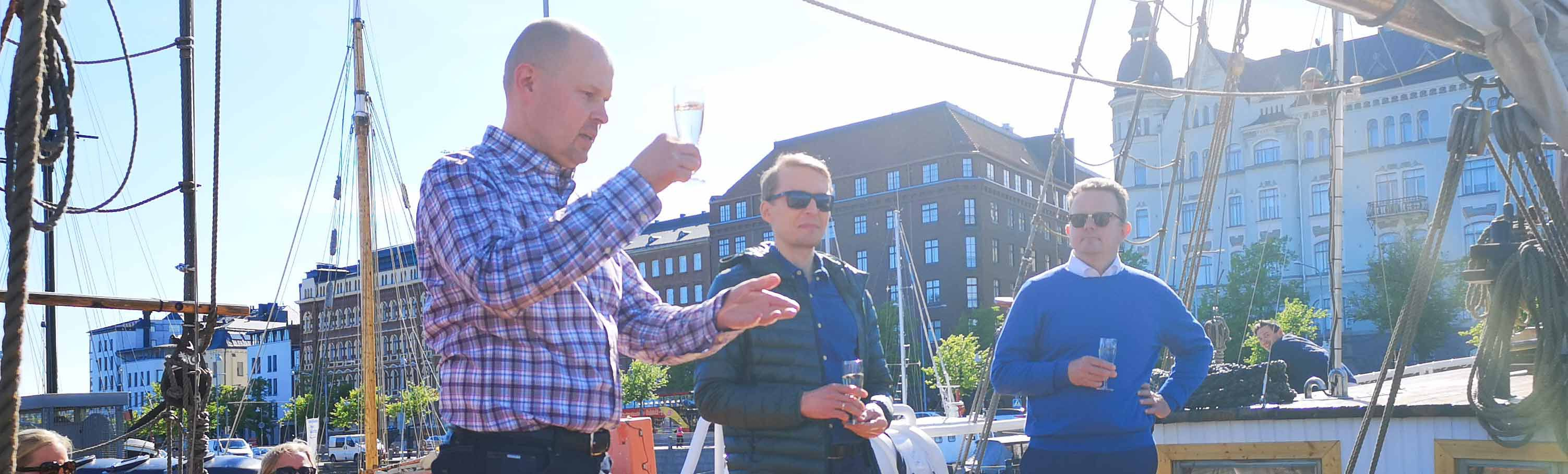 The founding partners Petri Heino, Marko Happonen, and Roy Nurmi welcome personnel and their avecs to SprintIT's 5th anniversary party on a sailing boat in Helsinki.
